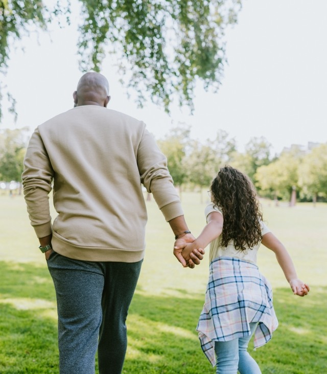 man and daughter in park