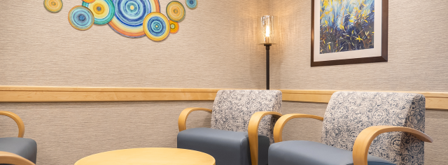 An interior photo of a group therapy room with colorful artwork