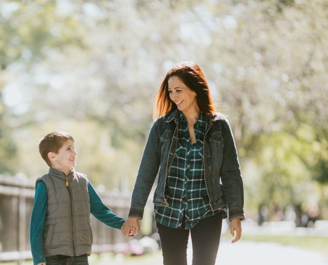 mother and son walking in park