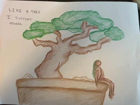 A sketch of a tree with a woman sitting underneath