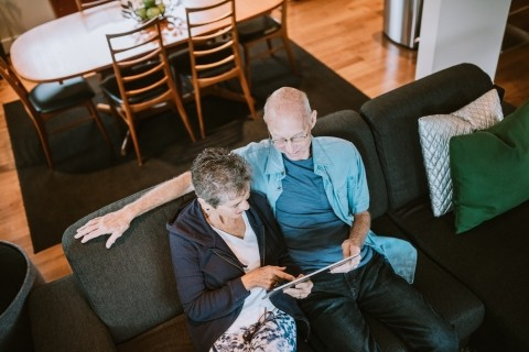 Elderly couple using a tablet computer