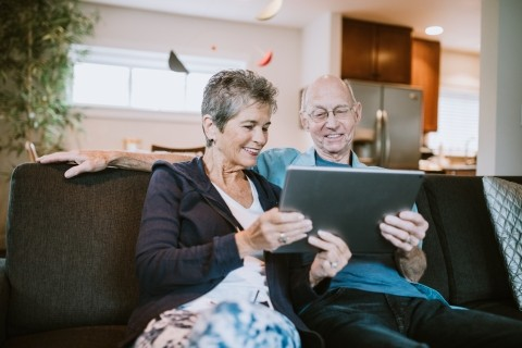 Elderly couple looking at a tablet computer
